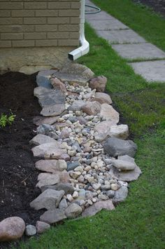 Garden Landscaping Trying to go without a downspout extension. Used some rocks and stones that were not being used.Garden Landscaping Trying to go without a downspout extension. Used some rocks and stones that were not being used. Landscaping With Rocks, Outdoor Landscaping, Front Yard Landscaping, Outdoor Gardens, Patio Ideas, Outdoor Ideas, Landscaping Ideas For Backyard, Cool Backyard Ideas, Sidewalk Landscaping