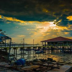 You can't have too many sunrise/sunset photos on instagram.. so here is another one. This one was taken just about 100metres from the previous one.  #penang #malaysia #penangbridge #sunset #seascapes #seaside #silhouette #clouds #rays #sunrays #sunlight #asia #southeastasia #boats #photography #dslr #wideangle #pier #jetty #fishingboats #pulaupinang #rulesofthird #goldenhour