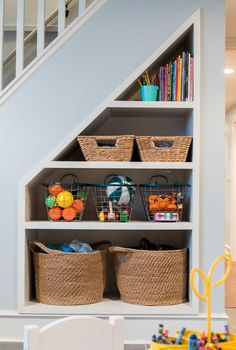 FHD renovated this Chicago basement and transformed the forward area into a kids play space. The typically unused area under the stairs was converted into a toy storage area.