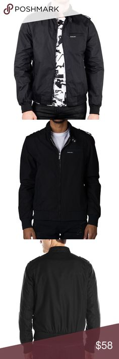Members Only Original Iconic Racer Bomber Jacket Members Only Men's Cold Weather Original Iconic Racer Jacket Size S Y61 - M.O. Military black bomber jacket from Members Only. - Bomber jacket silhouette with zip up closure. - Ribbed knit collar, sleeve cuffs and bottom hem. - Two front hand pockets with snap button closure. - Pop color lining. - Left chest pocket with logo detailing. - Utility pocket with zipper closure on left sleeve. - Inner welt pocket. - Shell: 100% nylon, Lining: 100%…