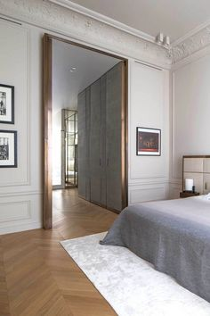 appartment in Paris, fitting room and bedroom with a giant brass door, interior design by Rodolphe Parente Interior Architecture, Interior And Exterior, Classic Architecture, Room Interior, Home Bedroom, Bedroom Decor, Bedroom Apartment, Paris Apartment Interiors, French Apartment