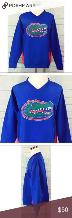 """Florida Gators UF Windbreaker Pullover Jacket NEW University of Florida Gators UF NCAA SEC Windbreaker Size XL Pullover Jacket Blue and Orange. New with tags. 100% polyester. The jacket is lined with two open front pockets and the huge Gator head logo on the front. Measurements are approximate arm pit to arm pit laying flat 28""""; shoulders 24.5""""; sleeves 24.5""""; length 30.5"""". Knights Apparel Jackets & Coats Windbreakers"""