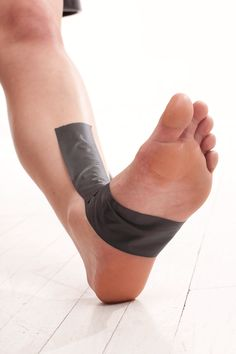 Kinesio taping tutorials for common running issues (plantar fasciitis, Achilles tendonitis, patellar tendonitis, shin splints, and ankle sprains). Videos on how to do each type of taping.