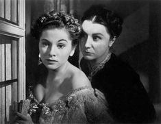 here is another scene from Rebecca, Ms. Danvers is the evil lady standing behind Joan Fontaine. brilliant acting.