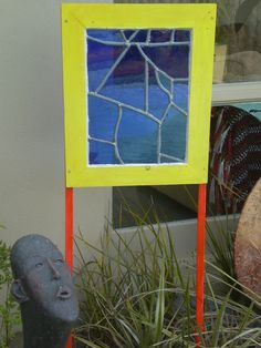 Beautiful blue glass from broken church window. Reassembled with lead and framed. Artwork number seven.