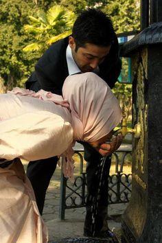 Muslim wife in Hijab & her husband