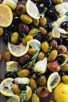 Tart, tangy and briny, this easy-to-prepare antipasto brings the bold bright flavors of the Mediterranean together in one colorful creation. Roasted Olives, Marinated Olives, Olive Recipes Appetizers, Lemon Herb, Mediterranean Diet Recipes, Savory Snacks, Appetisers, Winter Food, Cooking Recipes