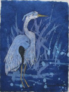A watercolor batik on rice paper of a Heron in shallow water. Original painting by Donna Savage.