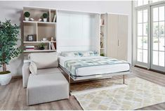 The space-saving Multimo Royal Murphy Wall Bed with Bookcase Storage and Sectional Sofa will work great in studio apartments and smaller bedrooms. Queen Murphy Bed, Murphy Bed Desk, Murphy Bed Plans, Murphy Bed With Sofa, Window Bed, Window Seats, Modern Murphy Beds, Bookcase Storage, Decorate Your Room