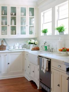 What about painting a color in the back of your upper cabinets and using some glass doors??