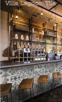 black and white patchwork tile on front of a bar