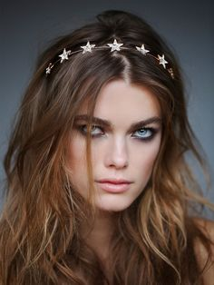 Geo Star Headband | Rhodium plated metal wire headband adorned with sparkly rhinestone star accents.
