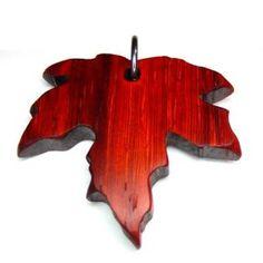 Padauk maple leaf pendant. Handmade. Handcrafted in Ontario. Yellowheart and Purpleheart pendants also available. www.dharmawanderlust.com/store Leaf Pendant, Ontario, Wanderlust, Pendants, Gift Ideas, Jewellery, Store, Fall, Handmade