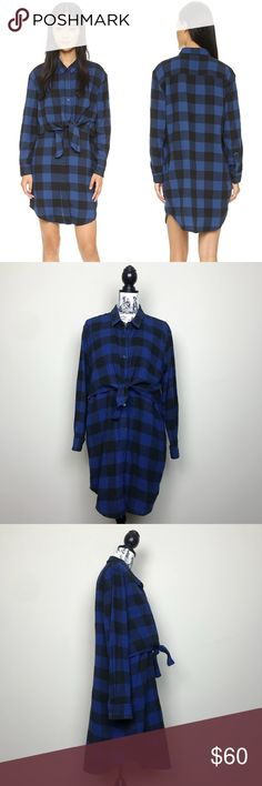 "CHEAP MONDAY Raw Flannel Dress Night Blue Check CHEAP MONDAY Raw Flannel Dress Night Blue Check  Layered dress composed of soft flannel. Tie at waist lends shape to silhouette. Fold-over collar and button placket. On seam pockets. Long sleeves with button cuffs. Unlined.   100% cotton  Length 35"" Bust 22"" Cheap Monday Dresses"