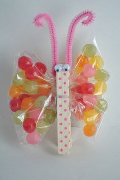 Cute, DIY party favor for kids.    1.} Paint a clothespin with an ink pen.  2.} Attach googly eyes and antennae  3.} Fill plastic baggies with a treat  4.} Clip clothespin in middle of bag to create butterfly wings