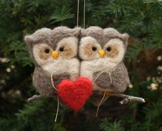 Two owls, perched on a wee branch, holding a heart and each other. Owls measure about 2.5 inches tall and both together are about 4 inches wide. All