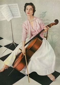 April Vogue 1953 - Wearing pink and white seperates by Tina Leser, combining cashmere, satin and piqué.