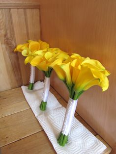 Yellow Calla Bouquets - simple and clean and a bright constrast to the bridesmaid dresses