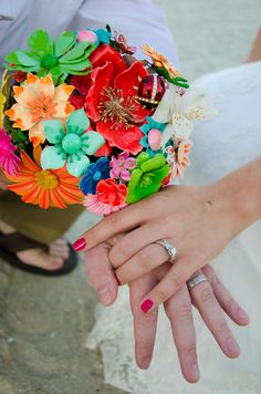 Hands with brooch bouquet.