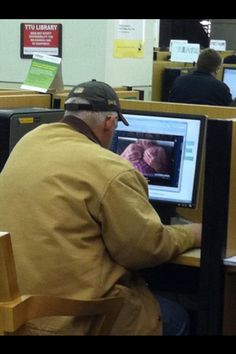 """Old man """"studying"""" on the first floor of the Texas Tech University Library."""