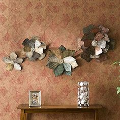 I'm not a floral person at all, but this Flower Wall Sculpture is pretty neat!