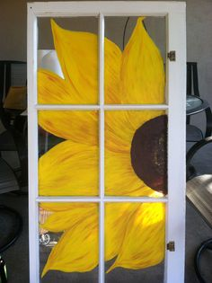 Painted sunflower on an old window