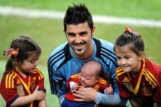 Spain's player David Villa poses with his adorable daughters. - ELOY ALONSO/Newscom/Reuters