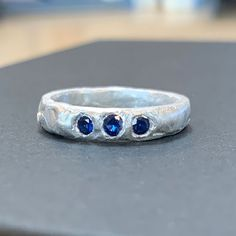 One of two great rings made by Tina in the Stone Setting in Wax Workshop. This ring was made with wax and set with three facetted sapphires that were then cast in place.