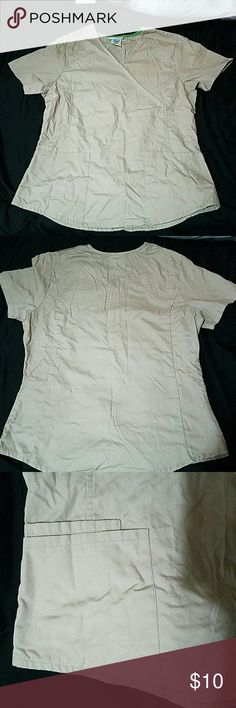 Khaki XS/XCH Scrub top 65% polyester 35% cotton Scrub top. Great condition, smooth feel, comfortable wear, double pocket on the bottom right side, single pocket on the bottom left side. Needs ironed. scrubstar  Tops Tees - Short Sleeve