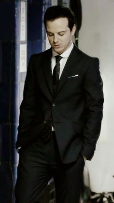 Andrew Scott wearing a Vivienne Westwood suit, Spencer Hart shirt and Alexander McQueen tie whilst portraying the character Jim Moriarty in Sherlock.