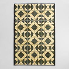 Sustainably handcrafted of raw bamboo with a fabric border, our exclusive natural fiber rug is printed with a sophisticated black and natural geometric design. Our smooth bamboo rugs are easy to care for and great for high-traffic areas.