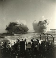 Frigate in North Atlantic - Depth charges explode astern a frigate in the North Atlantic, January 1944 (courtesy Library and Archives Canada/Lawrence/DND/PA-133246).