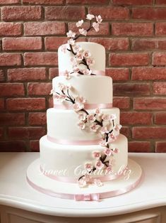 Spread the love Using fresh flowers on wedding cakes has become very popular, with many … Pink And Grey Wedding Cake, 4 Tier Wedding Cake, Wedding Cake Fresh Flowers, Elegant Wedding Cakes, Beautiful Wedding Cakes, Wedding Cake Designs, Beautiful Cakes, Cherry Blossom Cake, Cherry Blossom Wedding
