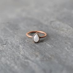 A shimmering oval of moonstone centers this electroformed copper ring from Hawkhouse. Born in Lincoln, Nebraska, self-taught metal mixed metal artist