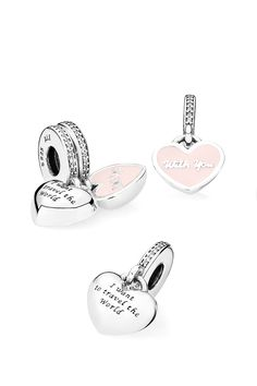 "Honor the unforgettable adventures that you and your most important travel companion have experienced by splitting and sharing this sterling silver and enamel dangle charm. Featuring the engraving ""I want to travel the world with you"", it is a symbolic memento of precious memories cherished forever in your heart. #PANDORA #PANDORAcharm"