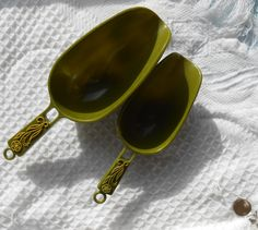 2 Vintage Avacado Green Scoops - Vintage Kitchen Tool / Ware - Early Plastic - Yellow Floral / Flowers on Handles by OldDustyRustyFun on Etsy