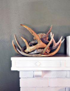Antler decor on fireplace mantel