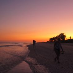 Shelling on Sanibel island in the sunset