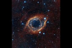 The European Southern Observatory used its VISTA telescope in Chile to capture a view of the planetary nebula that is usually invisible to the human eye, Space.com reported. The telescope's sensors are extremely sensitive to infrared light, which allowed it to pick up previously unknown strands of cold, thinly-spread gas (visible here as a dark red haze).