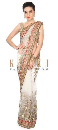 Buy this White saree adorn in floral motif embroidery in sequin only on Kalki