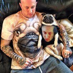 Human in pug shirt, pug in human shirt.
