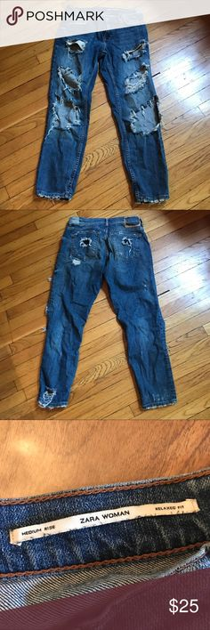 Zara Woman Distressed Jeans Size 4 Incredible pair of distressed jeans from Zara Woman. The coolest jeans I have ever seen. You can wear these the rest of summer and I can see them with a pair of tights underneath for fall and winter. Medium rise and relaxed fit. Size 4. Comes from a smoke and pet free home. Zara Jeans Straight Leg
