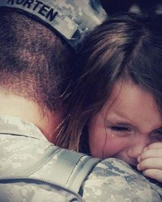 A man presumed to be a returned soldier and his daughter.
