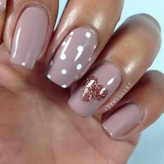 Dark Nude Nail Design with A Glittery Heart Accent.