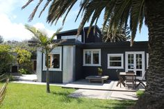 Funky, well-equipped beach bach in Waikanae Beach, Kapiti Coast Holiday Accommodation, Amazing Architecture, Coast, House Ideas, Homes, Patio, Mansions, House Styles, Beach