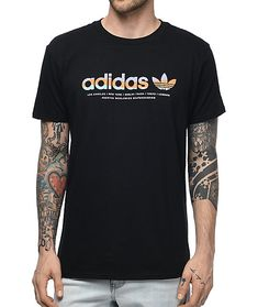 "Add soft color to your simple black tee look with the Linear shirt from adidas. A black 100% cotton tee features striped ""adidas"" print in purple, orange and teal on the front."