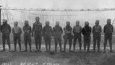 Soccer team of British soldiers with gas masks, World War I, somewhere in Northern France, 1916