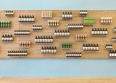 Shelves are supported by dowels slotted into pegboard walls at a store for skin and haircare brand Aesop in the Hamptons, New York.