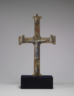 This Alter Cross is made of copper and is thought to be created in the early 13th century in France. On the the cross Christ appears dressed  and crowned. Christ depicted in this way is very rare.