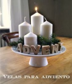 This Advent Wreath would be perfect for my kitchen island. I'd replace the white pillars for the purple and pink. I'd need to find a simple cake stand, too.